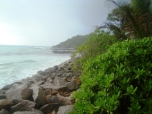 The Anse Kerlan coastline in Praslin, Seychelles now lined with rock armouring to protect from erosion.