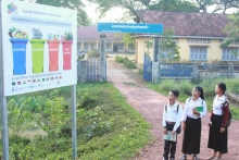 Signboard with primary school students in Tuol Torteung commune