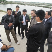 Discussing with extensive mangroves based shrimp farmers