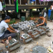 Nyan Lin Aung (left) making fuel-efficient stoves