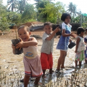 Kids planting mangroves