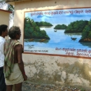 Local community members read through the mangrove awareness banner designed under this SGP