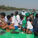 Students on a boat tour of the mangrove forests as part of the awareness camp