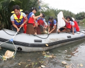 WideClean up action by school studentts facilitated by JGM at Jakarta project site2IndonesiaJGM2