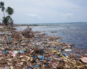 Dump site of a typical Maldivian island. Waste is dumped near the beach, polluting waterways.