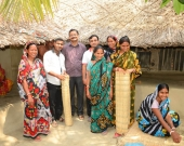 Sundarban women turned entrepreneurs by selling reed mats pose for a picture in Shyamnagar, Bangladesh.