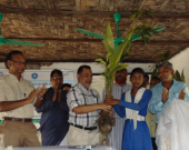 A student from Hnila Girl's High School accepts a sapling from Khursid Alam (CODEC) and Ishtiaq Uddin Ahmad (IUCN)