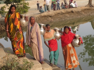 Fetching daily drinking water from far away ponds is a daily challenge for women in Shyamnagar