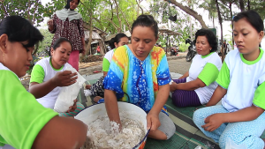 Rustima (centre) and her women's group make fish crackers